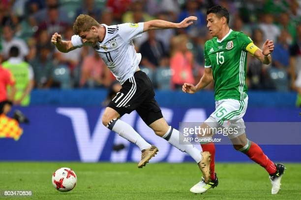 Mexico's defender Hector Moreno challenges Germany's forward Timo Werner during the 2017 FIFA Confederations Cup semifinal football match between...