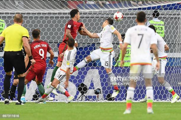 TOPSHOT Mexico's defender Hector Moreno heads the ball and scores during the 2017 Confederations Cup group A football match between Portugal and...