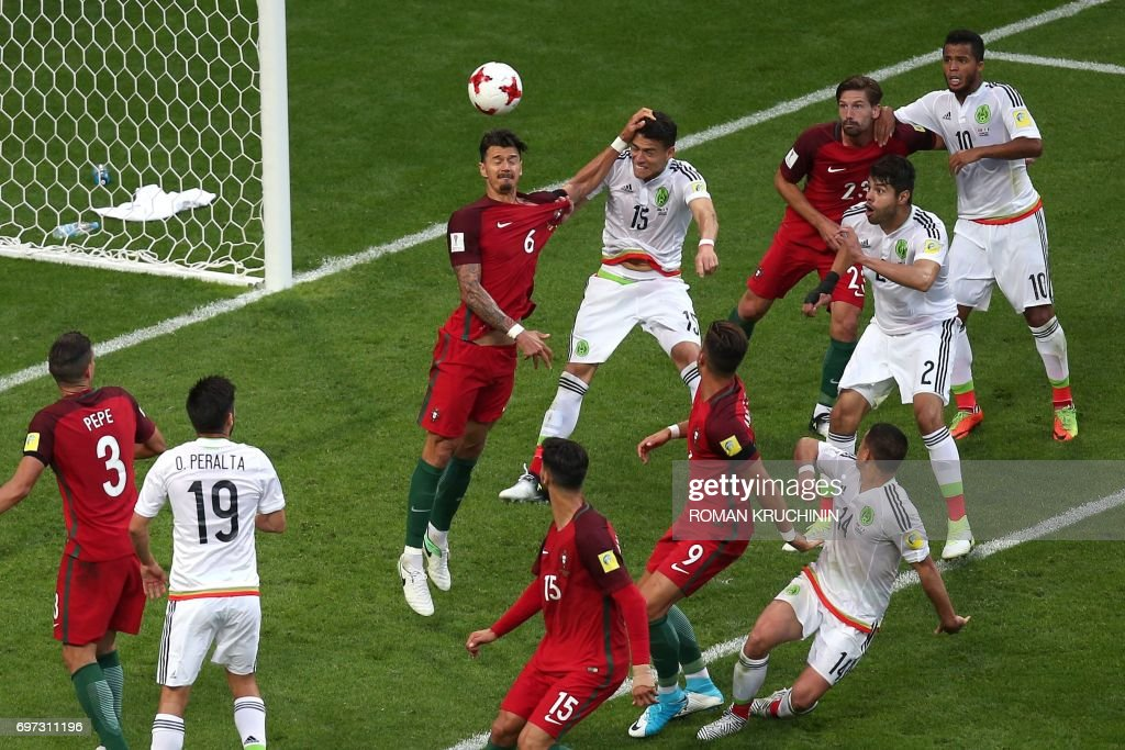 TOPSHOT - Mexico's defender Hector Moreno (C 15) heads the ball to score during the 2017 Confederations Cup group A football match between Portugal and Mexico at the Kazan Arena in Kazan on June 18, 2017. / AFP PHOTO / Roman Kruchinin