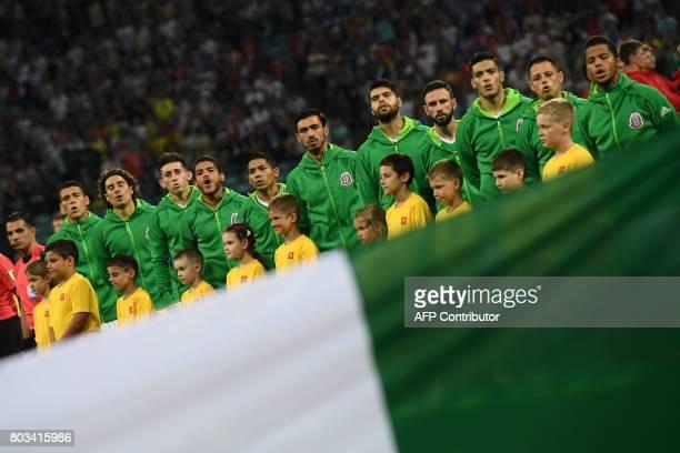 Mexico's defender Hector Moreno Mexico's goalkeeper Guillermo Ochoa Mexico's midfielder Hector Herrera Mexico's midfielder Jonathan Dos Santos...