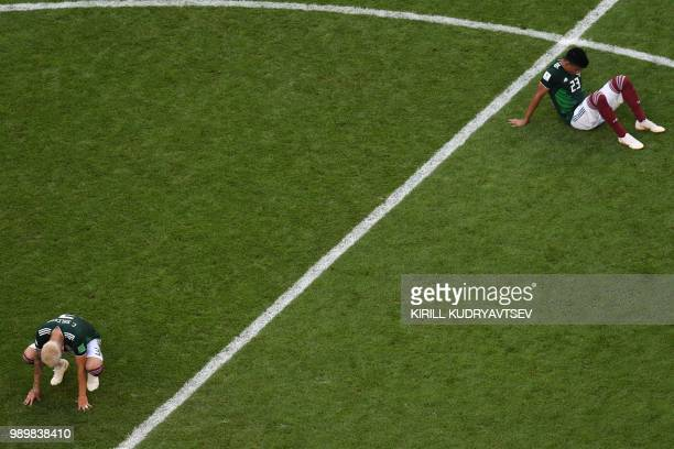 TOPSHOT Mexico's defender Jesus Gallardo and Mexico's defender Carlos Salcedo react to their defeat at the end of the Russia 2018 World Cup round of...