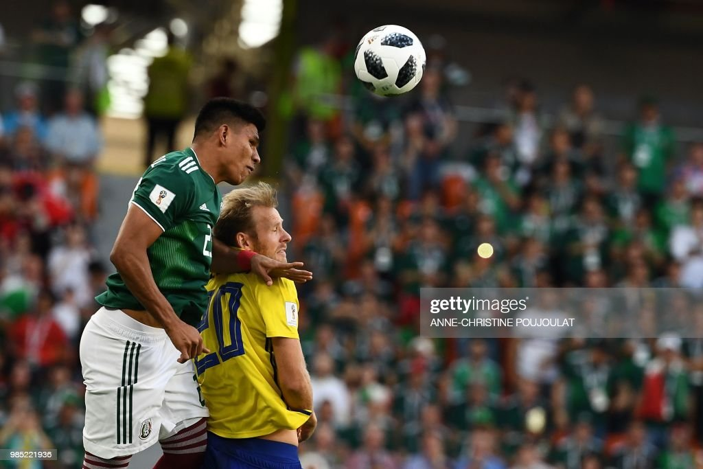 TOPSHOT - Mexico's defender Jesus Gallardo (L) and Sweden's forward Ola Toivonen vie for the ball during the Russia 2018 World Cup Group F football match between Mexico and Sweden at the Ekaterinburg Arena in Ekaterinburg on June 27, 2018. (Photo by Anne-Christine POUJOULAT / AFP) / RESTRICTED