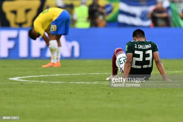 Mexico's defender Jesus Gallardo reacts after losing the Russia 2018 World Cup round of 16 football match between Brazil and Mexico at the Samara...