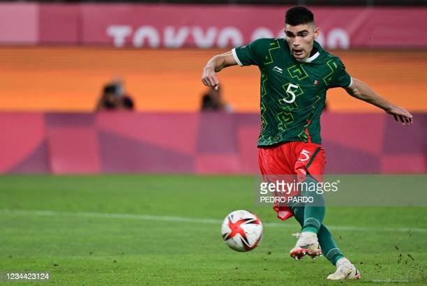 Mexico's defender Johan Vasquez takes a penalty during the Tokyo 2020 Olympic Games men's semi-final football match between Mexico and Brazil at...