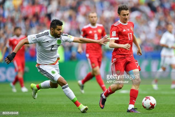 Mexico's defender Nestor Araujo fights for the ball against Russia's midfielder Alexander Golovin during the 2017 Confederations Cup group A football...