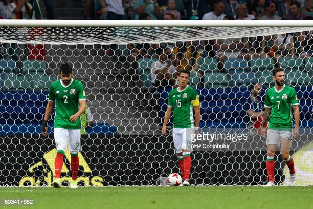 Mexico's defender Nestor Araujo Mexico's defender Hector Moreno and Mexico's midfielder Miguel Layun react after Germany scored during the 2017 FIFA...