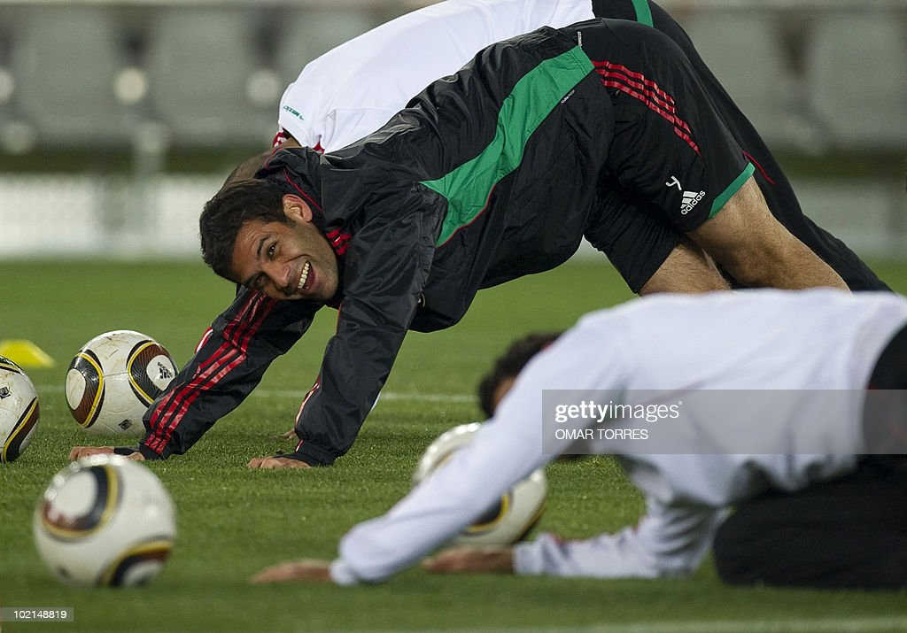 Mexico's defender Rafael Marquez (L) smiles as he takes part in a training session in Polokwane, South Africa, on June 16, 2010. Mexico will face France on June 17 in a Group A game of the 2010 World Cup 2010.