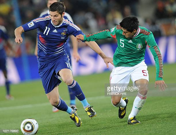 Mexico's defender Ricardo Osorio challenges France's striker AndrePierre Gignac during the 2010 World Cup group A first round football match between...