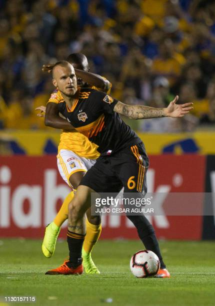 Mexico's Enner Valencia vies for the ball with US Houston Dynamo Aljaz Struna during the second game of the quarterfinal of the CONCACAF Champions...