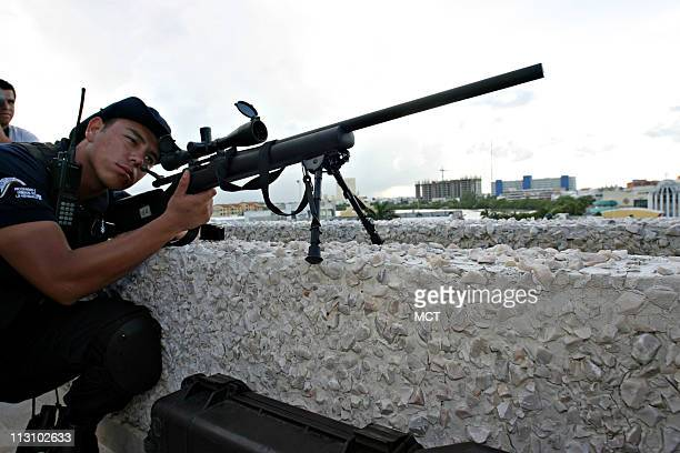 Mexico's equivalent of an FBI agent is one of many guarding the Convention Center of Cancun Mexico against snipers during the 73rd Interpol General...
