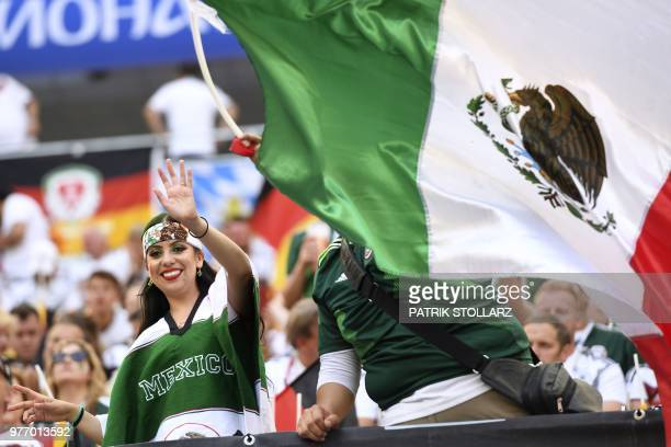 Mexico's fan cheers next to a Mexican national flag prior to the Russia 2018 World Cup Group F football match between Germany and Mexico at the...