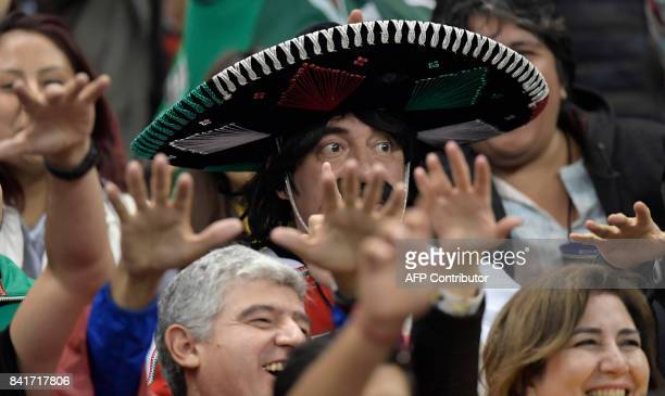 Mexico´s fans celebrates their goal against Panama during their 2018 FIFA World Cup qualifier football match against at the Azteca stadium on...