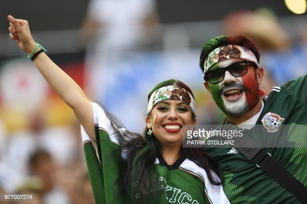 TOPSHOT Mexico's fans cheer prior to the Russia 2018 World Cup Group F football match between Germany and Mexico at the Luzhniki Stadium in Moscow on...
