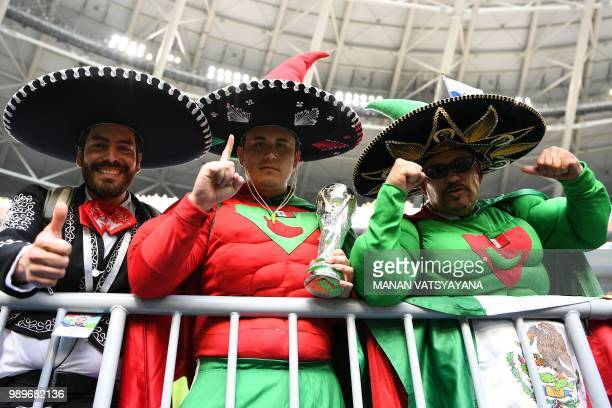 Mexico's fans cheer prior to the Russia 2018 World Cup round of 16 football match between Brazil and Mexico at the Samara Arena in Samara on July 2,...