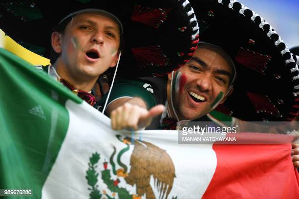 Mexico's fans cheer with the Mexican national flag prior to the Russia 2018 World Cup round of 16 football match between Brazil and Mexico at the...