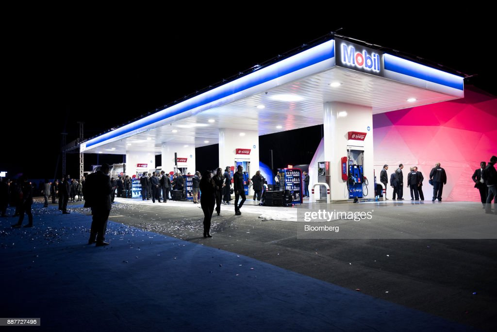 Mexico's first Exxon Mobil Corp. gas station is unveiled during an event in Santiago de Queretaro, Mexico, on Wednesday, Dec. 6, 2017. Exxon Mobil Corp. is joining Chevron Corp. and other U.S. refiners to supply the newly free Mexican fuel market. Exxon Mobil indicated Wednesday that it will open 50 service stations by the end of first quarter and invest more than $300 million in Mexico's energy sector. Photographer: Jonathan Levinson/Bloomberg via Getty Images