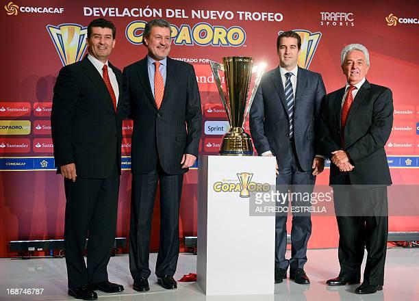 Mexico's football team coach Jose Manuel de la Torre the director of Santander Mexico Marcos Martinez CONCACAF General Director Enrique Sanz and the...