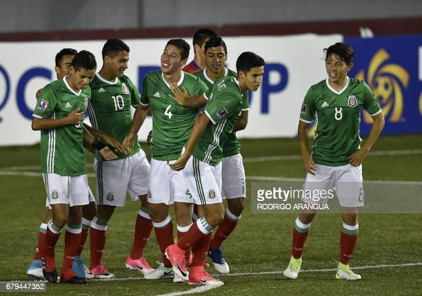 Mexico's footballer Luis Olivas celebrates with teammates after scoring against Costa Rica during their Under 17 Concacaf qualifying football match...