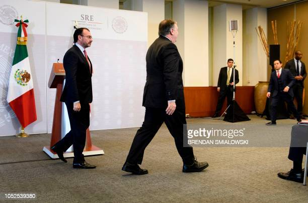 Mexico's Foreign Minister Luis Videgaray Caso and US Secretary of State Mike Pompeo leave after making a statement to the press at the Ministry of...