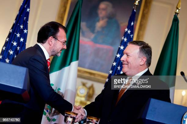 Mexico's Foreign Minister Luis Videgaray Caso and US Secretary of State Mike Pompeo shake hands after a meeting at the State Department May 7 2018 in...