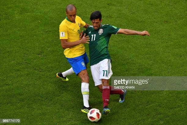 Mexico's forward Carlos Vela vies for the ball with Brazil's defender Miranda during the Russia 2018 World Cup round of 16 football match between...