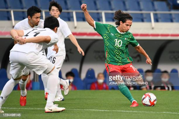Mexico's forward Diego Lainez attempts a shot during the Tokyo 2020 Olympic Games men's bronze medal football match between Mexico and Japan at...