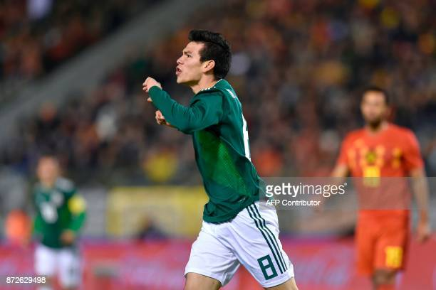 Mexico's forward Hirving Lozano celebrates after scoring a goal during the international friendly football match between Belgium and Mexico at the...