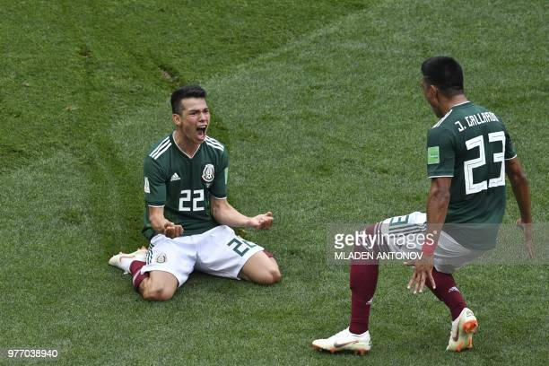 TOPSHOT Mexico's forward Hirving Lozano celebrates after scoring during the Russia 2018 World Cup Group F football match between Germany and Mexico...