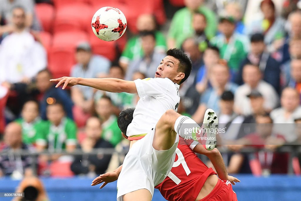Mexico's forward Hirving Lozano eyes the ball during the 2017 Confederations Cup group A football match between Mexico and Russia at the Kazan Arena Stadium in Kazan on June 24, 2017. /