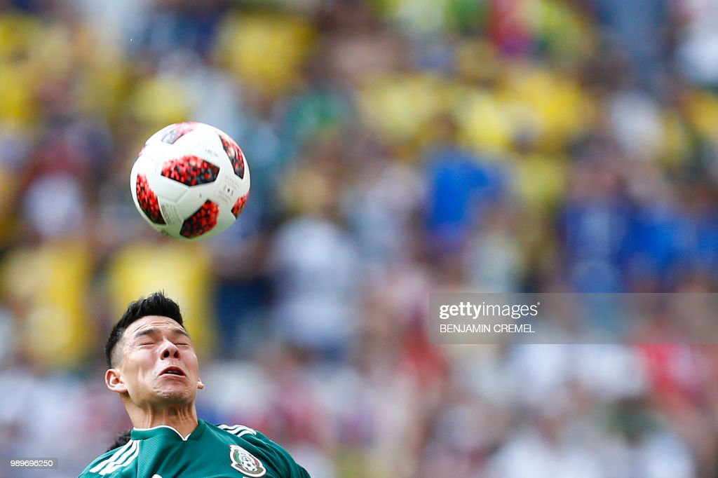 Mexico's forward Hirving Lozano heads the ball during the Russia 2018 World Cup round of 16 football match between Brazil and Mexico at the Samara Arena in Samara on July 2, 2018. (Photo by BENJAMIN CREMEL / AFP) / RESTRICTED