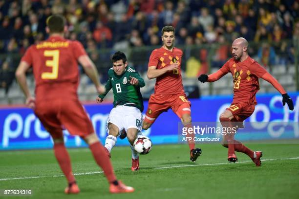 Mexico's forward Hirving Lozano shoots and scores a goal during the international friendly football match between Belgium and Mexico at the King...