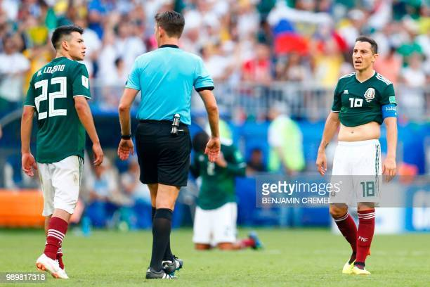 Mexico's forward Hirving Lozano talks with Italian referee Gianluca Rocchi in front of Mexico's midfielder Andres Guardado at the end of the Russia...