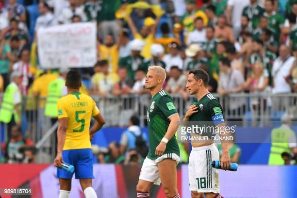 Mexico's forward Javier Hernandez and Mexico's midfielder Andres Guardado react following the team's defeat in the Russia 2018 World Cup round of 16...