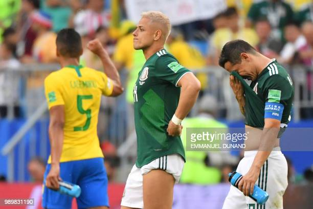 TOPSHOT Mexico's forward Javier Hernandez and Mexico's midfielder Andres Guardado react following the team's defeat in the Russia 2018 World Cup...