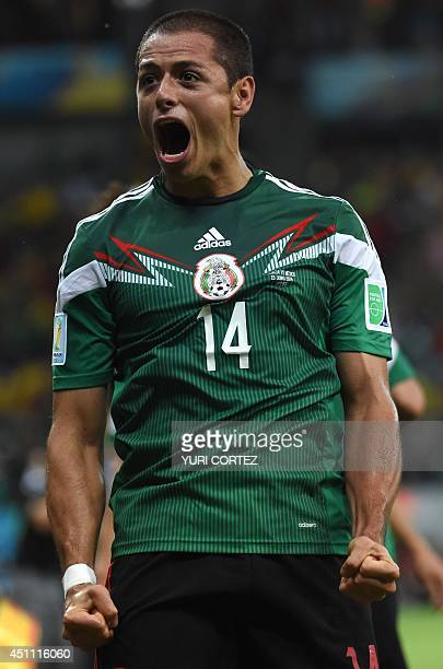 Mexico's forward Javier Hernandez celebrates after his team scored during a Group A football match between Croatia and Mexico at the Pernambuco Arena...
