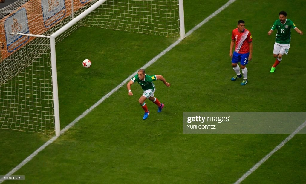 Mexico's forward Javier Hernandez (L) celebrates after scoring against Costa Rica during their 2018 FIFA World Cup qualifier football match in Mexico City on March 24, 2017. /