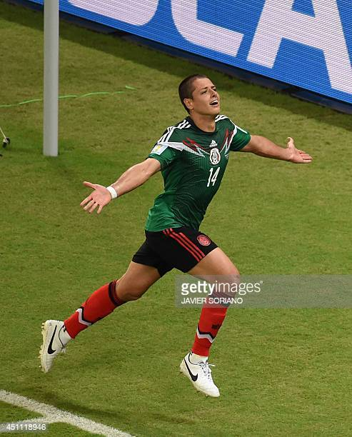 Mexico's forward Javier Hernandez celebrates scoring his team's third goal during a Group A football match between Croatia and Mexico at the...