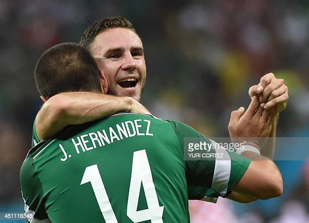Mexico's forward Javier Hernandez celebrates with Mexico's defender Miguel Layun after scoring the 03 during a Group A football match between Croatia...