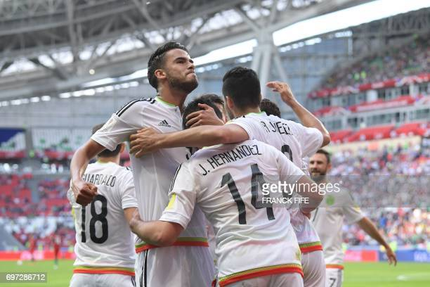 Mexico's forward Javier Hernandez celebrates with team mates after scoring during the 2017 Confederations Cup group A football match between Portugal...