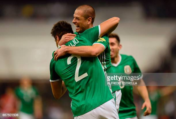 Mexico's forward Javier Hernandez celebrates with teammate Nestor Araujo after scoring against Costa Rica during their 2018 FIFA World Cup qualifier...