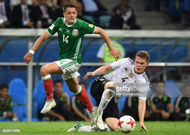Mexico's forward Javier Hernandez challenges Germany's defender Matthias Ginter during the 2017 FIFA Confederations Cup semifinal football match...