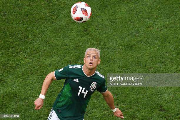 Mexico's forward Javier Hernandez eyes the ball during the Russia 2018 World Cup round of 16 football match between Brazil and Mexico at the Samara...