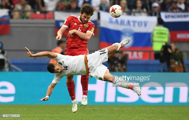 Mexico's forward Javier Hernandez fights for the ball against Russia's defender Georgiy Dzhikiya during the 2017 Confederations Cup group A football...