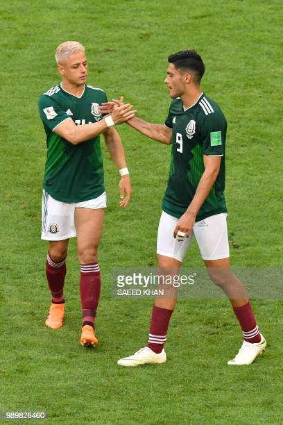 Mexico's forward Javier Hernandez greets Mexico's forward Raul Jimenez after their defeat during the Russia 2018 World Cup round of 16 football match...