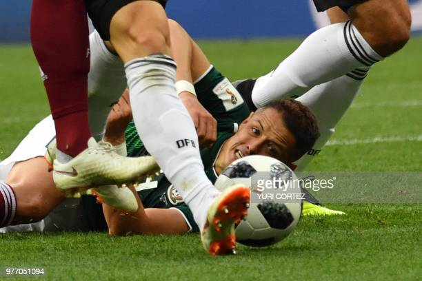 Mexico's forward Javier Hernandez lies on the pitch during the Russia 2018 World Cup Group F football match between Germany and Mexico at the...