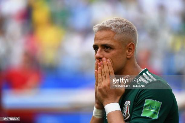 Mexico's forward Javier Hernandez reacts prior to the start of the Russia 2018 World Cup round of 16 football match between Brazil and Mexico at the...