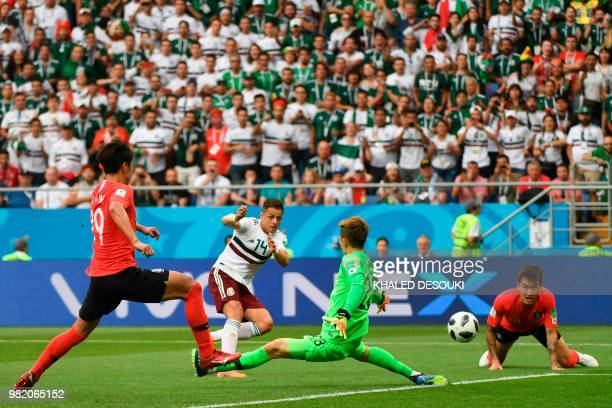 TOPSHOT Mexico's forward Javier Hernandez scores their second goal past South Korea's goalkeeper Cho Hyunwoo during the Russia 2018 World Cup Group F...