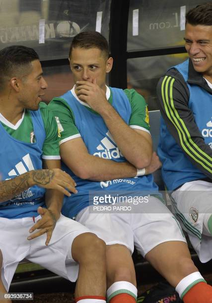 Mexico's forward Javier Hernandez talks with teammates Mexico's Javier Aquino and Mexico's Hector Moreno during their World Cup 2018 CONCACAF...