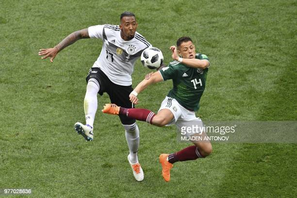 TOPSHOT Mexico's forward Javier Hernandez vies for the ball with Germany's defender Jerome Boateng during the Russia 2018 World Cup Group F football...