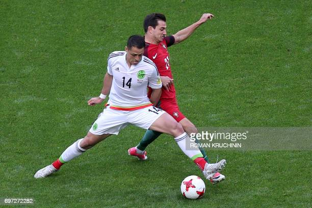 TOPSHOT Mexico's forward Javier Hernandez vies with Portugal's defender Cedric during the 2017 Confederations Cup group A football match between...
